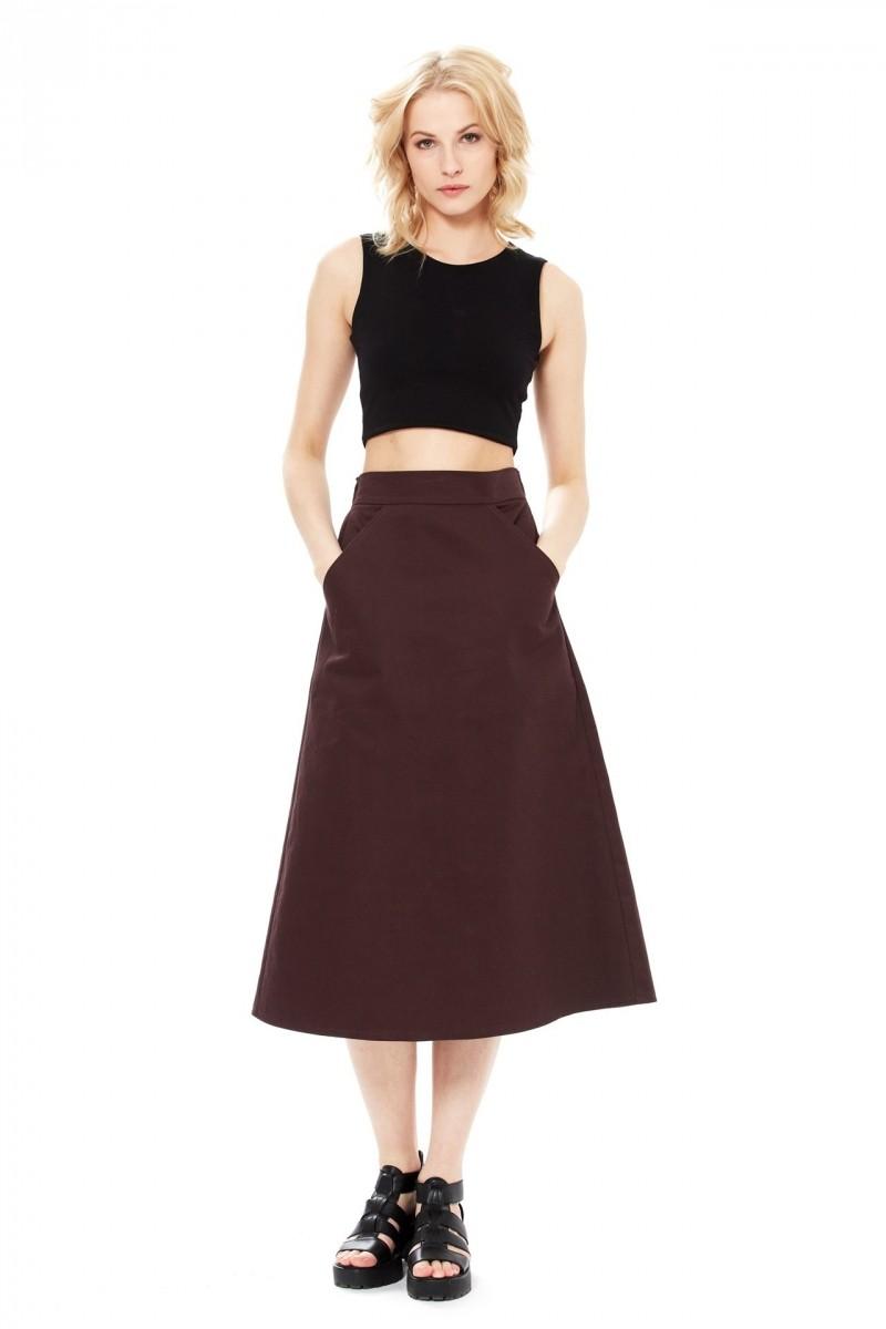 модные юбки 2018: а-силуэт черная ниже колена с карманами