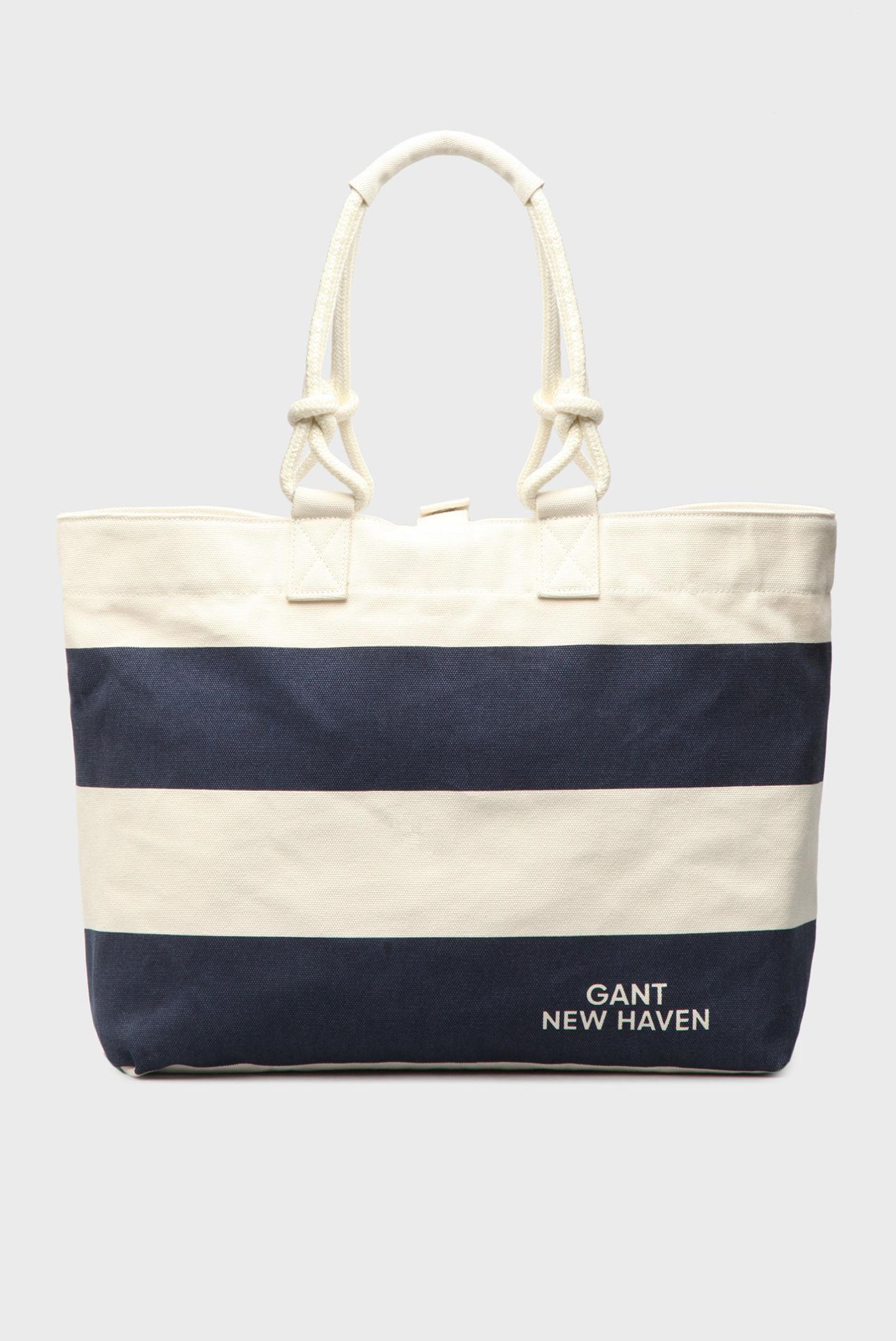 сумки 2018 года модные тенденции: пляжная черная с белым полоска