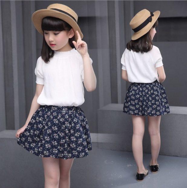 детская мода 2018: юбка темная в белый цветок под белую блузку